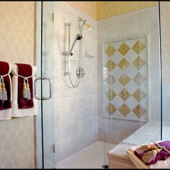 tiled bathroom and glass shower door