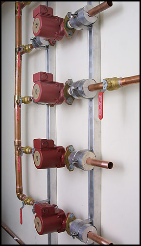 red plastic and copper pipes