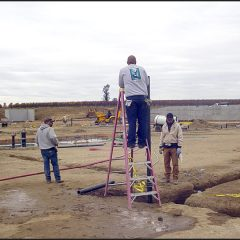 Crew testing waste water lines before inspection.